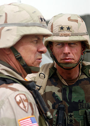 David Petraeus - Maj. Gen. David H. Petraeus (right), commanding general, 101st Airborne Division (Air Assault), looks on as Lt. Gen. William S. Wallace, V Corps commanding general speaks to soldiers, March 21, 2003, Kuwait.