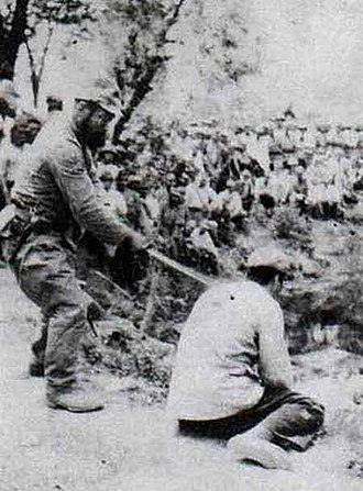 Historical negationism - A Chinese POW about to be beheaded by a Japanese officer with a shin gunto during the Nanking Massacre.