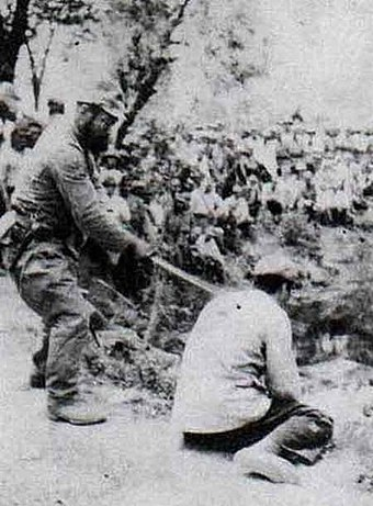 "A Chinese POW about to be beheaded by a Japanese officer with a shin gunto during the Nanking Massacre. Photo 09 (The ""Shame"" Album).jpg"
