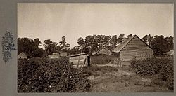 Old black-and-white photo of wooden shacks