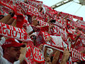 Polish supporters singing the national anthem.jpg