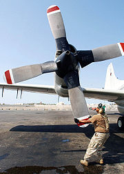 Rotating the Hamilton Standard 54H60 propeller on a US Navy EP-3E Orion's number four engine as part of pre-flight checks. The Orion is an anti-submarine warfare aircraft