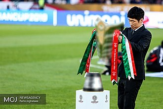 AFC Asian Cup - Current trophy, carried by Park Ji-sung.
