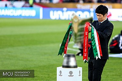 The new trophy, carried by Park Ji-sung. Qatar v Japan – AFC Asian Cup 2019 final 05.jpg