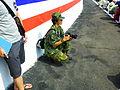 ROCA Female Photographer Kneeling for Take a Shot 20121006.jpg