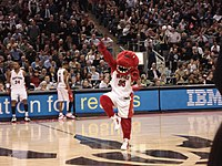 The Raptor Mascot rallying the crowd during a game.