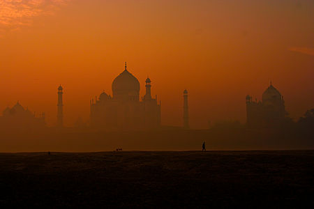 """A rear view of Taj Mahal.Author:Narender.  Jury Comments """"The Taj Mahal is probably one of the most photographed monuments in the world  and definitely in this competition. This particular image gives an impressive view of the silhouette, showing also the adjoining buildings. The complex seems to wake up,out of the mist. It gives context and mystery at the same time showing just a bit more than on most pictures""""    This is a photo of ASI monument number N-UP-A28."""