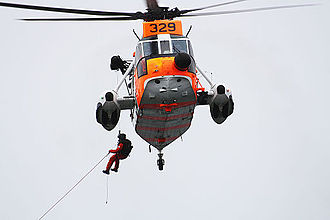 No. 330 Squadron RNoAF - Rescue swimmer being hoisted from the Sea King