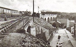 Redruth railway station - A train pulls away from the station and over the viaduct in the early 1900s
