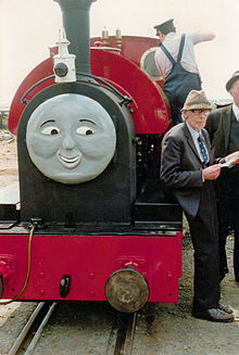 Wilbert Awdry in May 1988, with one of his creations, Peter Sam on the Talyllyn Railway, Wales