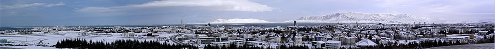 Panorama of Reykjavík seen from Perlan with the mountains Akrafjall (middle) and Esja (right) in the background