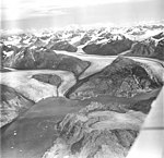 Riggs Glacier, tidewater glacier terminus, hanging glacier in the background and glacial remnents in the foreground, August 27 (GLACIERS 5856).jpg