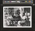 Robert Louis Stevenson, Lloyd Osbourne, and Kalakaua in the King's boathouse (PP-96-14-011, original).jpg