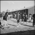 Rohwer Relocation Center, McGehee, Arkansas. Changing classes at the temporary high school quarters. - NARA - 538924.tif
