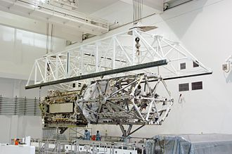 STS-117 - An overhead crane lifts the S3/S4 truss inside the Space Station Processing Facility
