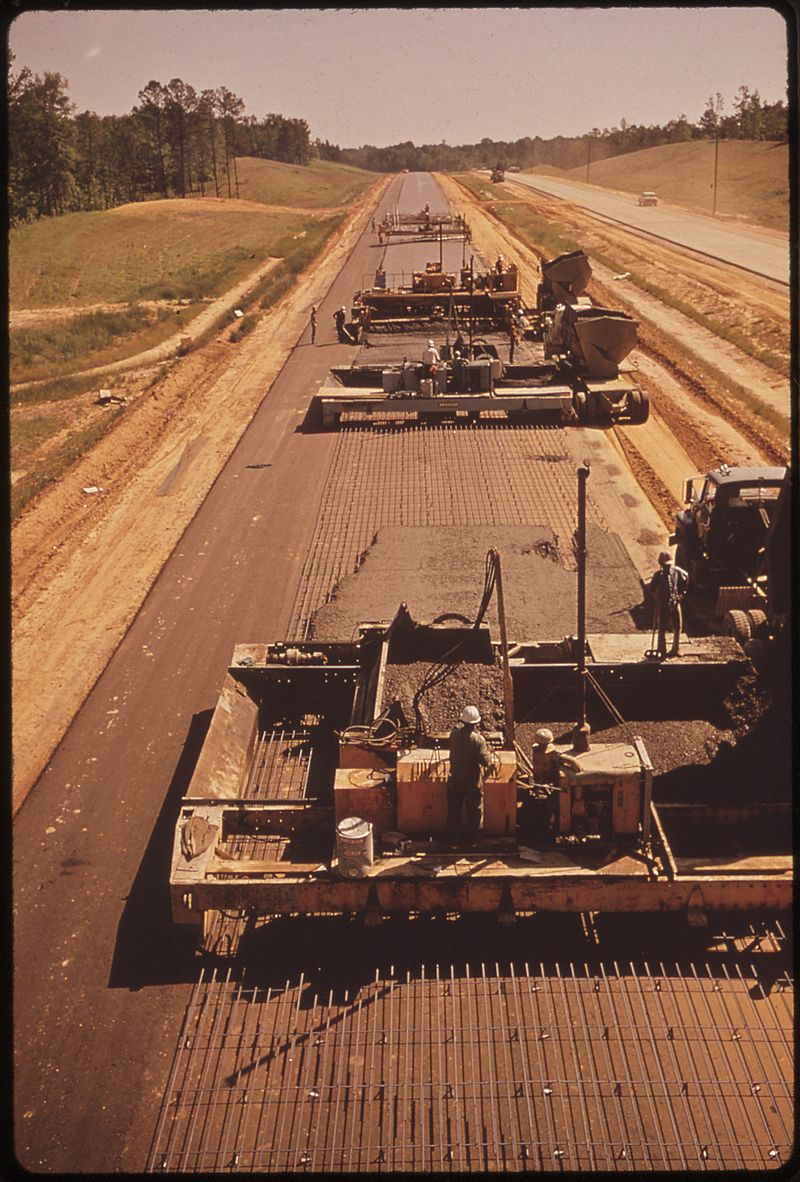 STEEL RODS, MADE FROM SHREDDED AUTOS, ARE BEING USED FOR REINFORCEMENT IN THIS SECTION OF I-55, NORTH OF DURANT. IT... - NARA - 546265.jpg