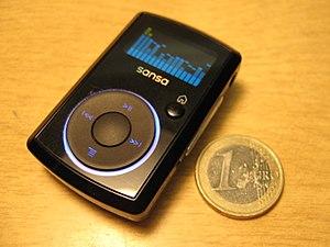 SanDisk Sansa - Sansa Clip beside a 1 euro coin