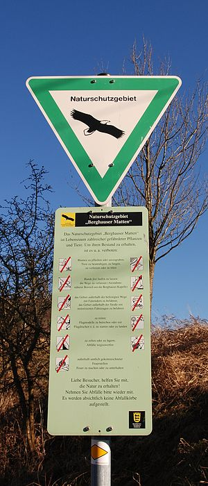 Naturschutzgebiet - Old sign (only in West Germany) on a nature reserve, with a description, decrees and prohibitions