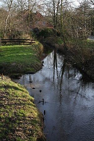 Schönebecker Aue - The Aue downstream from the weir at Schloss Schönebeck. In the background the old water mill