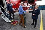 Secretary Kerry and Danish Foreign Minister Jensen Prepare to Shake Hands With Danish Deputy Chief of Protocol Lassen Upon Arrival in Ilulissat, Greenland (27720616151).jpg