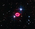 Shock wave around supernova 1987A (captured by the Hubble Space Telescope).jpg