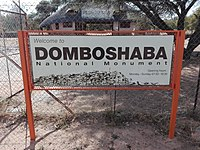 Sign on the entrance gate at Domboshaba National Monument, Botswana.jpg
