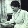 Sister Nivedita reading a book.png