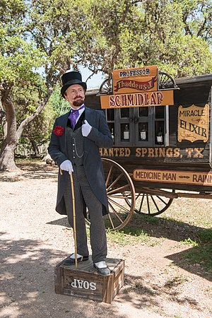 "Snake oil - Historical intrepreter Ross Nelson as ""Professor Thaddeus Schmidlap"", resident snake-oil salesman at the Enchanted Springs Ranch and Old West theme park, Boerne, Texas."