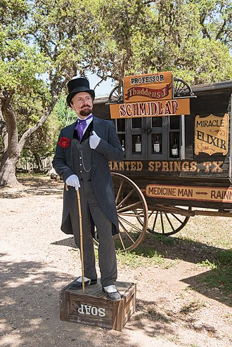 "Snake oil - Historical interpreter Ross Nelson as ""Professor Thaddeus Schmidlap"", resident snake-oil salesman at the Enchanted Springs Ranch and Old West theme park, Boerne, Texas."