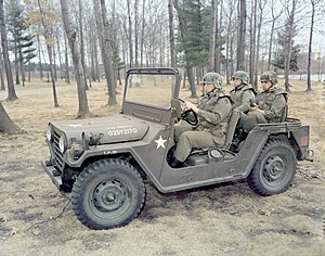 Personnel Armor System for Ground Troops - U.S. soldiers riding in a jeep in 1977, while wearing prototypes of the PASGT vest and helmet.