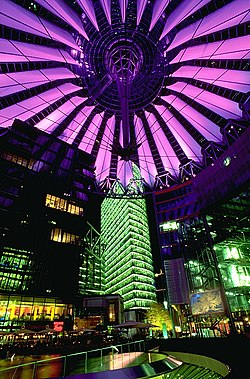 """Berlin's Sony Center reflects the global reach of a Japanese corporation. Cyberpunk is often set in urbanized, artificial landscapes, and """"city lights at night"""" was one of the genre's first metaphors for cyberspace (Neuromancer)."""