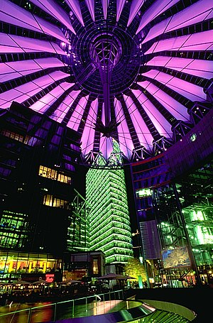 Helmut Jahn - An illuminated, suspended, oval roof covers the 102 m span of the central Forum of the Sony Center, Berlin.
