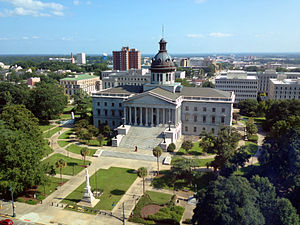 Modern display of the Confederate flag - View of the South Carolina State House with the Confederate Monument in front