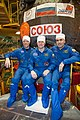 Soyuz TMA-06M crew members in front of their spacecraft.jpg