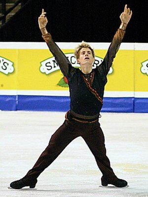 Single skating - Jeffrey Buttle, a men's single skater, performs an inside edge spread eagle.