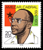 Amílcar Cabral, with the flag of Guinea-Bissau in the background, on a DDR stamp