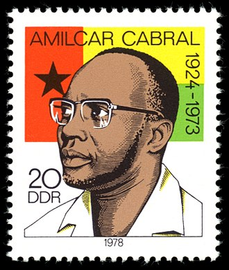 History of Guinea-Bissau - Amílcar Cabral, with the flag of Guinea-Bissau on a stamp