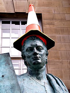 Statue of Hume with traffic cone hat