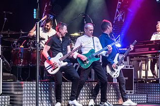 "Status Quo (band) - Performing at Partille Arena, Sweden, on 22 April 2017; left-to-right: Leon Cave (drums), Richie Malone, Francis Rossi, John ""Rhino"" Edwards and Andy Bown (keyboard)"