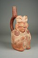 Stirrup Spout Bottle with Seated Figure MET 64.228.41.jpg