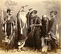Studio portrait of a Marathi theatrical troupe in Bombay in the 1870s.jpg