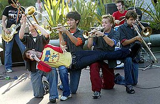 Suburban Legends - Suburban Legends in 2002. (LtR: Brian Klemm, Brian Robertson, Vince Walker, Aaron Bertram, Derek Rock, Dallas Cook. Across: Tim Maurer. Not pictured: Chris Maurer.)