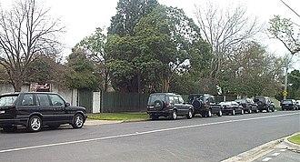 Toorak, Victoria - SUVs line a residential street in Toorak
