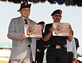 Sushil Kumar Shinde releasing 'Memoirs'-NSG, at the 28th NSG Raising Day Function, at Manesar, Gurgaon, Haryana on October 16, 2012. The Director General, National Security Guard, Shri Subhash Joshi is also seen.jpg