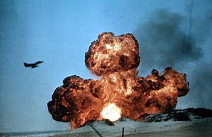TA-4 Skyhawk flies ovr bomb explosion in 1984.JPEG