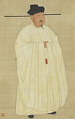 Painted image of a man standing erect, wearing white silk robes, black hat, black shoes, and sporting a black mustache and goatee