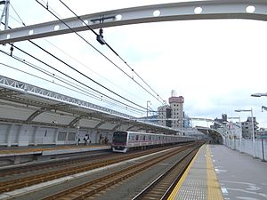 Takatsustation-expresstrainpassing-august2014.jpg