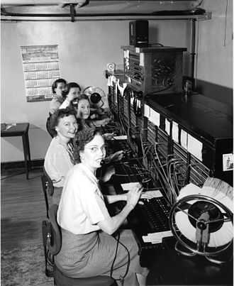 Switchboard operator - Seattle telephone operators in a private branch exchange in 1952.