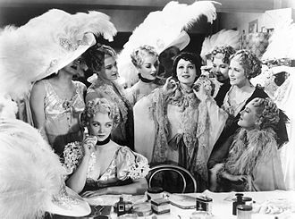 Luise Rainer - Anna Held (Rainer) exhibits her jewels to the envious Audrey Dane (Virginia Bruce, seated) in The Great Ziegfeld
