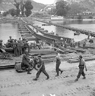 1st Somersetshire Engineers - The first Bailey bridge nears completion alongside 'David', 28 August 1944
